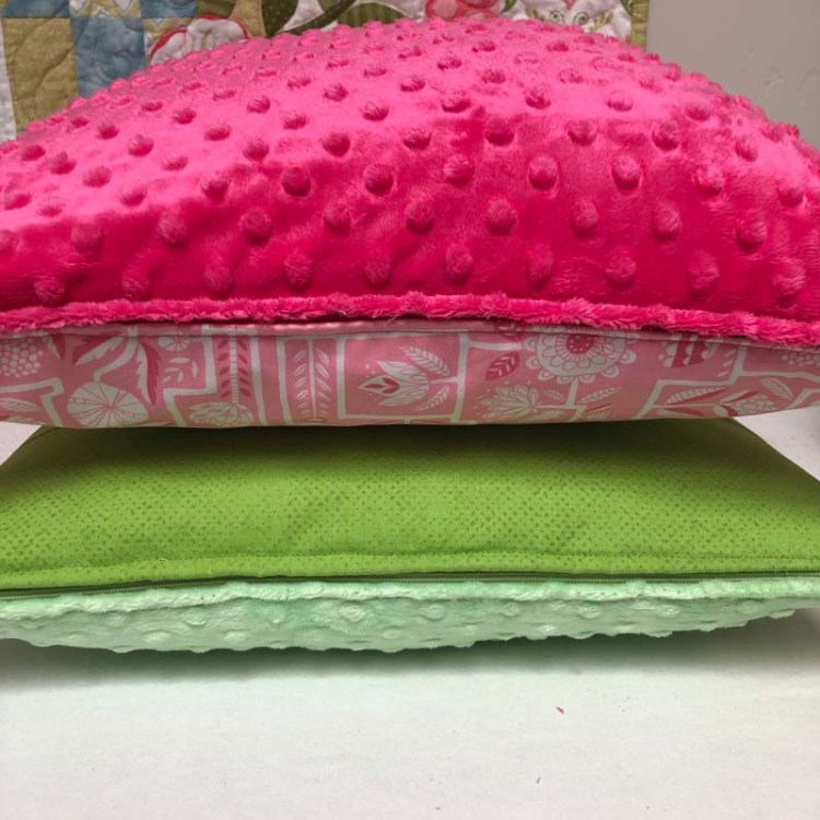 "16"" pillows have a pocket to hold books or small stuffed animals.  They also have a zipper closure at the bottom.  Made and designed by Julie Cefalu @ The Crafty Quilter."
