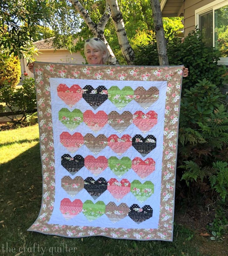 Ombre Love Quilt and pattern by Julie Cefalu @ The Crafty Quilter using a layer cake of Olive's Flower Market by Lella Boutique for Moda Fabrics