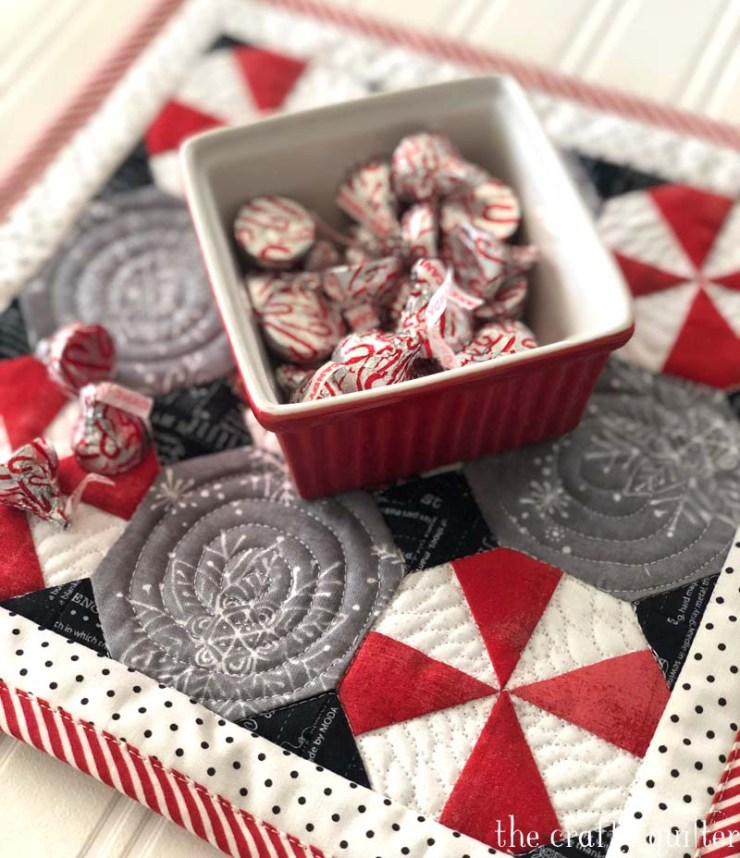 Peppermint Snowball Candy Mat is perfect to set underneath a bowl or plate of candy and cookies.  Free pattern from The Crafty Quilter