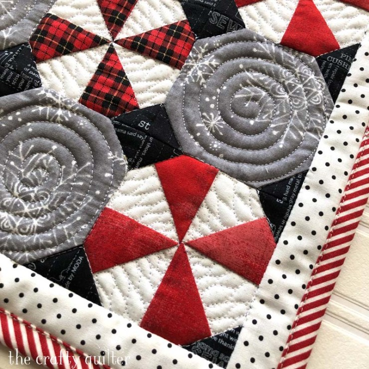 Quilting detail of the Peppermint Snowball Candy Mat; a free pattern from The Crafty Quilter.