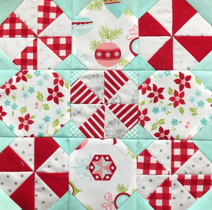 Charm pack version of Peppermint Snowball Candy Mat by The Crafty Quilter.