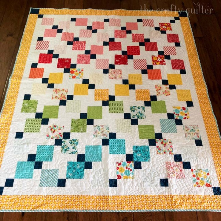 Quilt made by Julie Cefalu @ The Crafty Quilter for her Disappearing 9-patch quilt along.