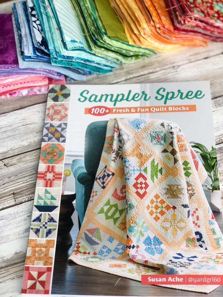 A rainbow of fabric squares are cut and ready for some Sampler Spree quilt blocks @ The Crafty Quilter.  I'm using the book Sampler Spree by Susan Ache