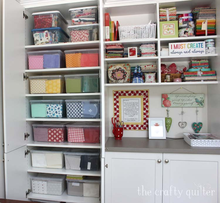 Fabric storage includes clear plastic pins hidden behind cabinet doors.