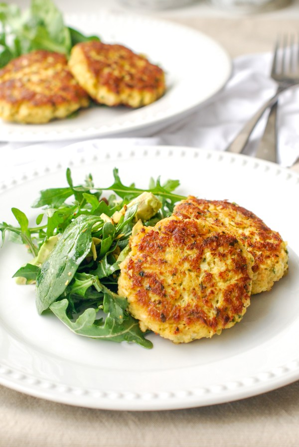 Shrimp and Artichoke Cakes on a plate with arugula.