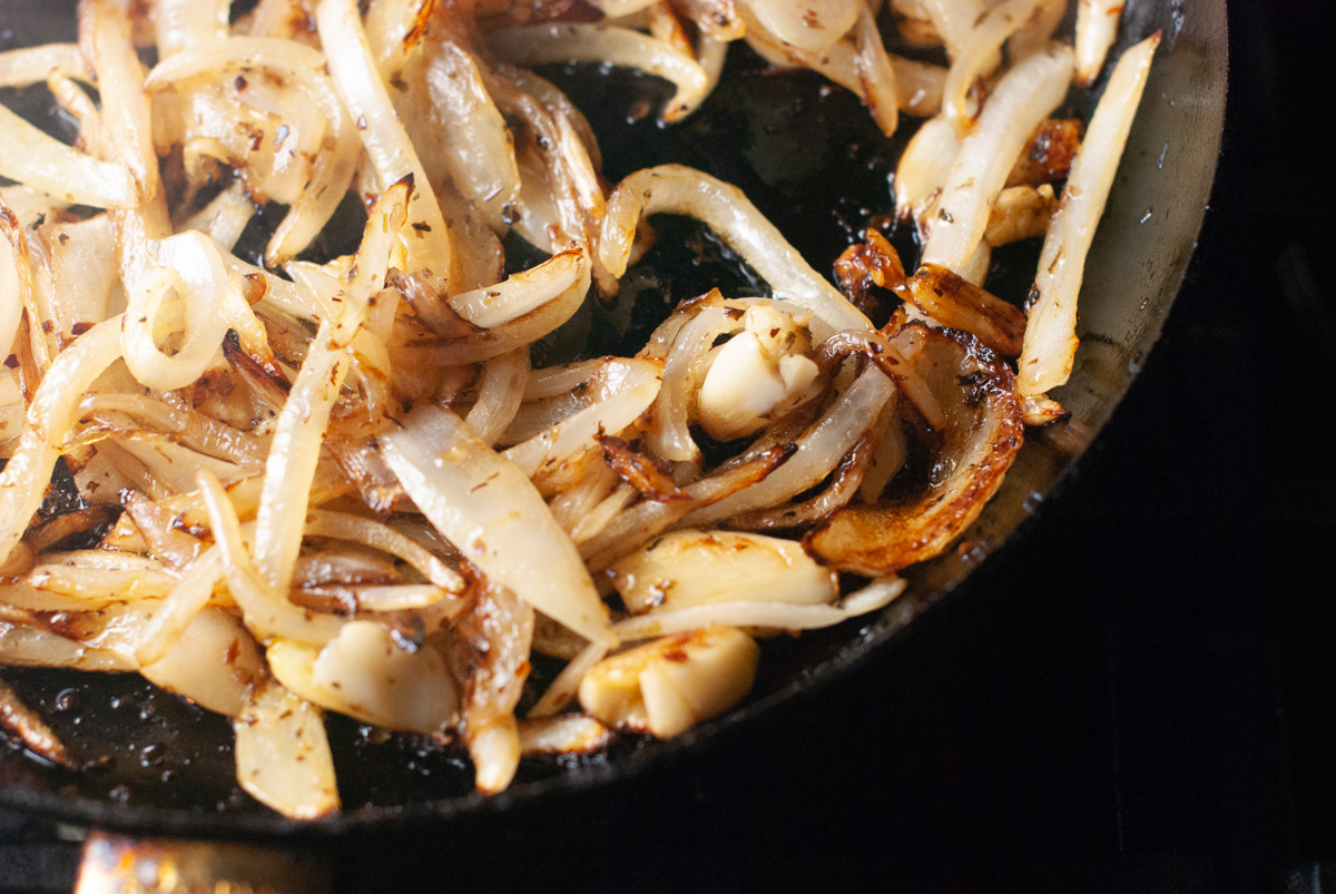 Saute pan with caramelizing onions.