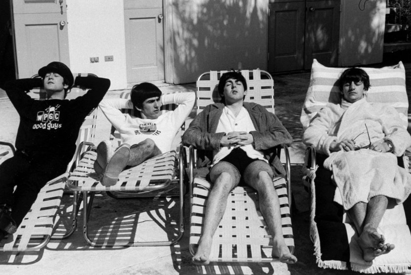 (L-R) John Lennon, George Harrison, Paul McCartney & Ringo Starr, members of British rock group, The Beatles, relaxing on lounge chairs at poolside of the Deauville Hotel.  (Photo by Bob Gomel/The LIFE Images Collection/Getty Images)