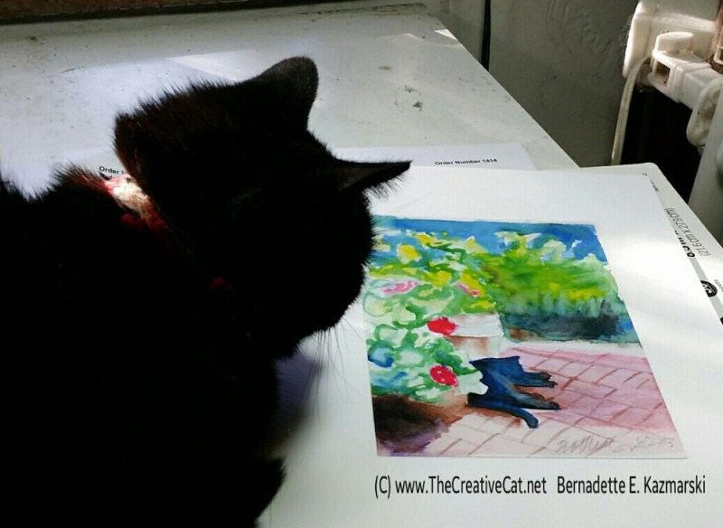 Mimi studies the painting of herself.