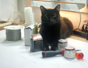 black cat with tools