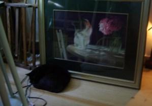 black cat near painting