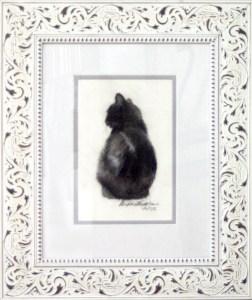 matted framed sketch of cat