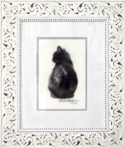 matted framed sketch of cat
