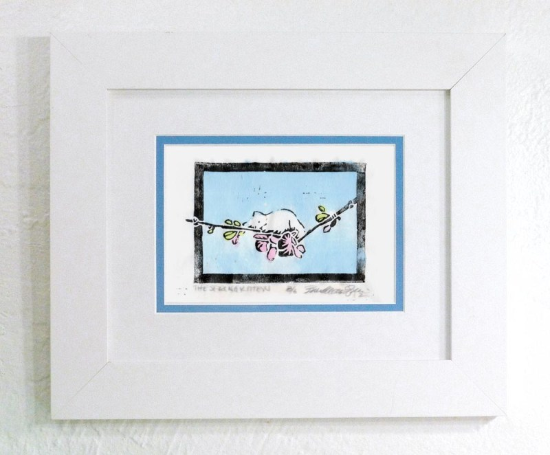 """""""The Spring Kitten"""" linoleum block print on rice paper, black ink and hand-colored with watercolors, white frame with blue and white mats"""
