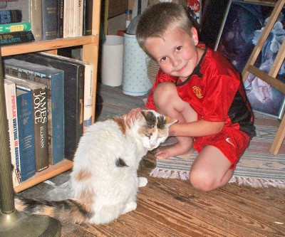 little boy with calico cat