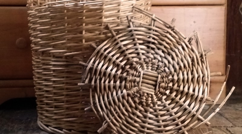 The battered laundry basket.
