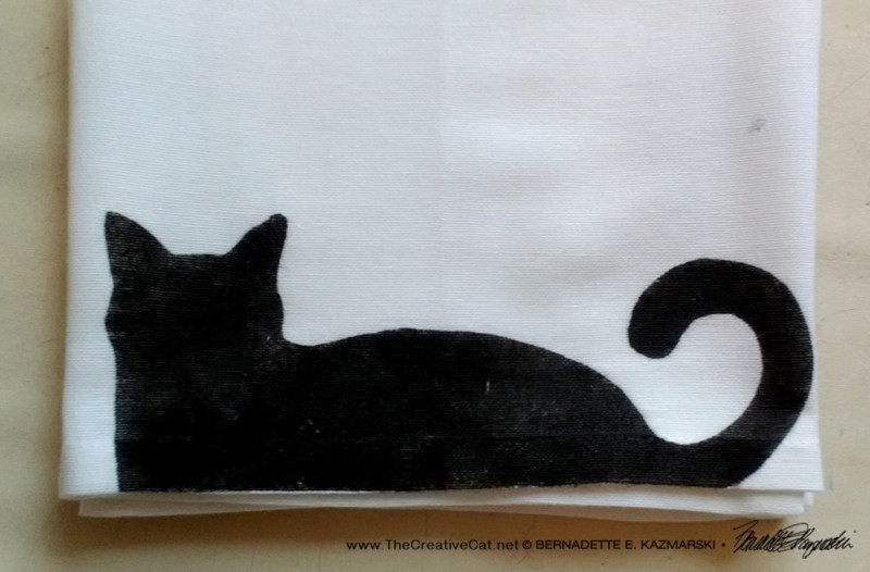 Bella! dish towel in black.