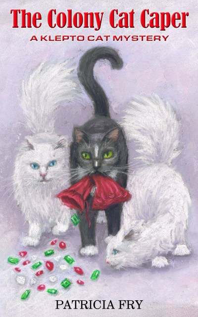 three cats with gems