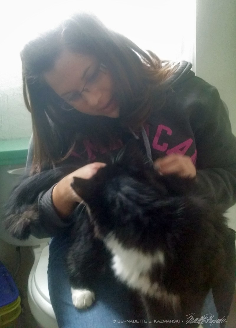 black and white cat with young woman