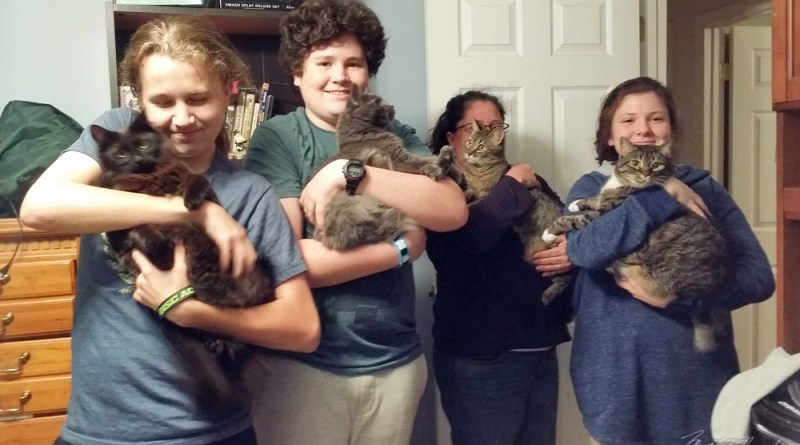 Happy family with all their cats!