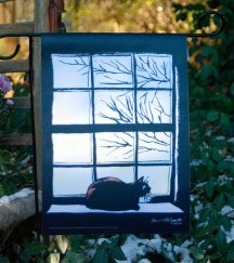 garden flag with cat on windowsill
