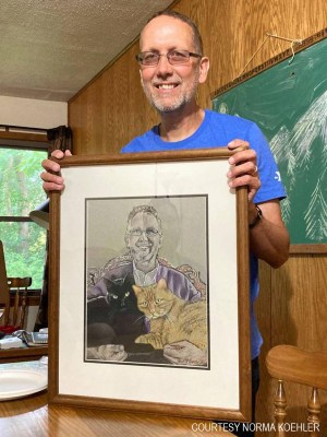 Keith with his portrait.