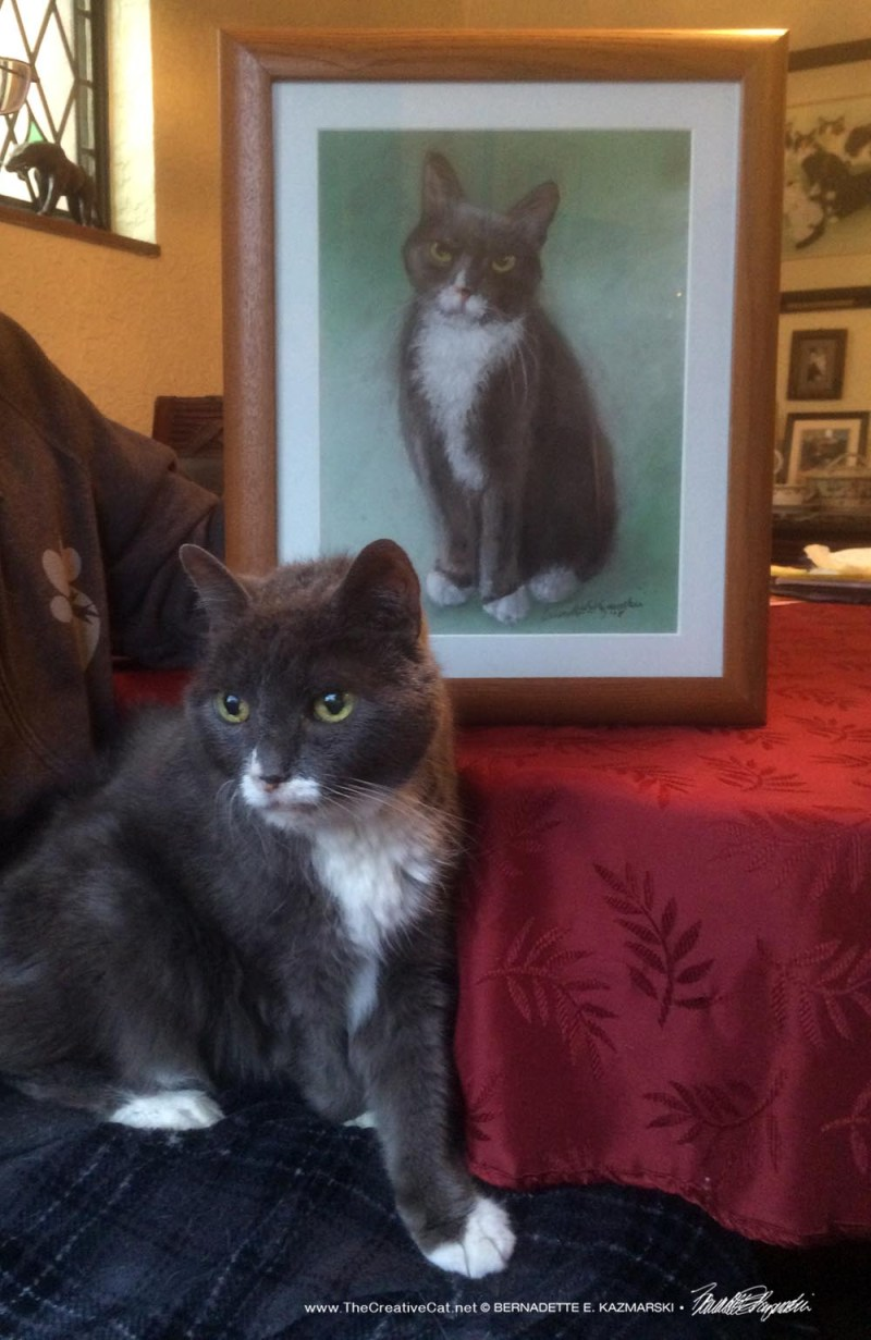 Oscar posing with his portrait.