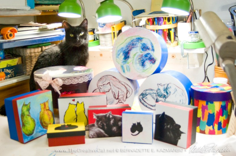 black cat with keepsake boxes