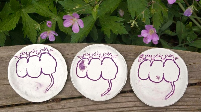Three Cats trinket dishes all lined up.