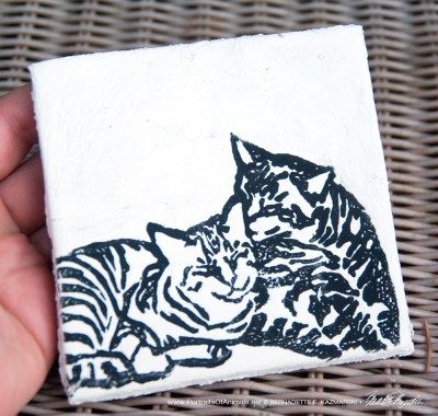 "Air-dry clay tile, ""Let Me Clean You Up"" in black."