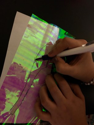 Placing a piece of paper underneath makes it easier to see and cut the outline.
