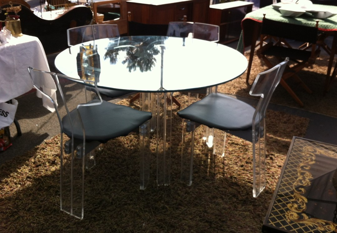 $1200 for this glass and lucite table with zero scratches and mucho appeal.