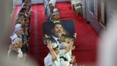 A man holds up an image of former Egyptian President Mohamed Morsi during a funeral prayer in absentia Credit Halil FidanAnadolu AgencyGetty Images