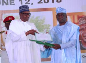 Kola Abiola receiving M.K.O. Abiola's national honour of GCFR from President Buhari, July 7, 2018