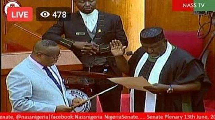 Rochas Okorocha being sworn in as a senator