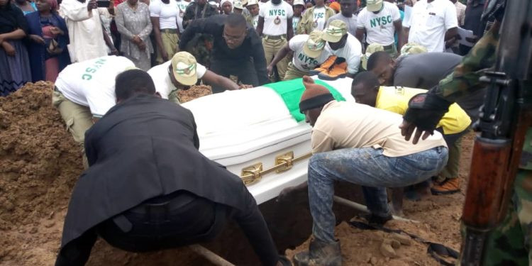 Owolabi's remains being lowered by his fellow Corpers- Photo-Chanels TV