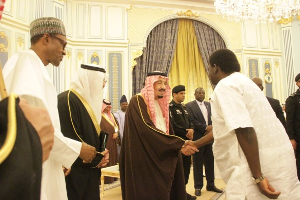 President Buhari, Femi Adesina in handshake with King Salman of Saudi Arabia