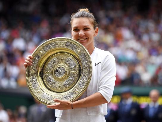 Simona Halep holding the spoils of her victory (Getty Images)