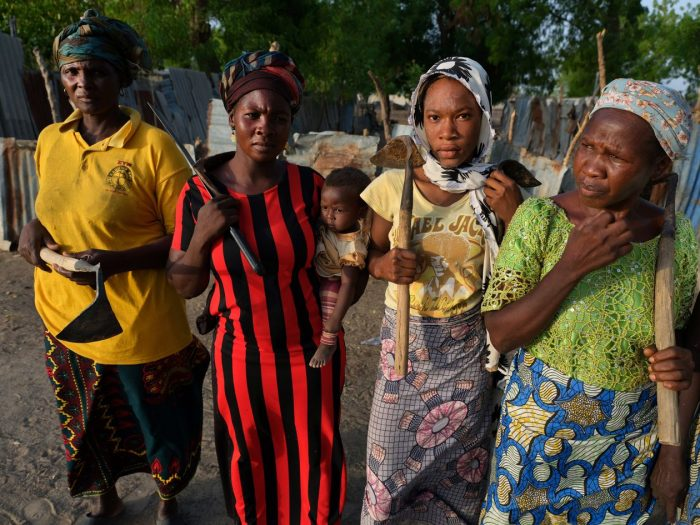 Sarah James, at left, with others living near the Maimalari barracks in Maiduguri. The women said they gave up land they had farmed for years to make way for the expansion of the base's cemetery