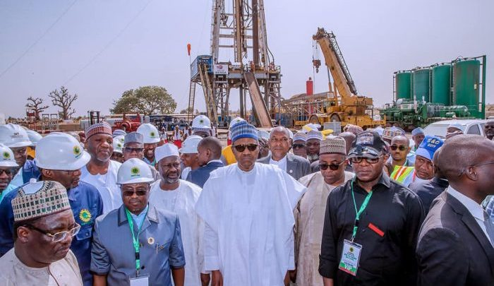 President Buhari with NNPC top brass during the flag off in February