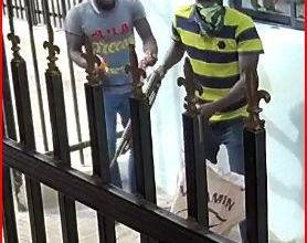Armed robbers attacking a bank, one of them holding a pump action rifle