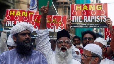 FILE PHOTO: File photo of demonstrators in Mumbai, India holding placards and shouting slogans during a protest against the alleged rape and murder of a 27-year-old veterinarian on the outskirts of Hyderabad. Four men suspected of the crime were shot dead by police on Friday. Photo taken on December 3, 2019. REUTERS/Francis Mascarenhas/File Photo