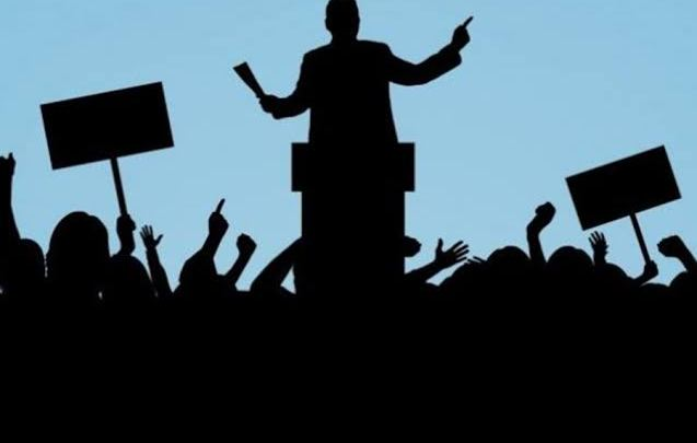 Silhouette of a politician on campaign stage