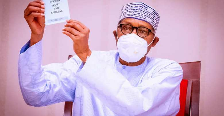 Buhari displays certifcate after taking the jab, says it is safe