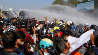 Protesters in Myanmar drenched by water cannon(Photo credit: CBC.ca)
