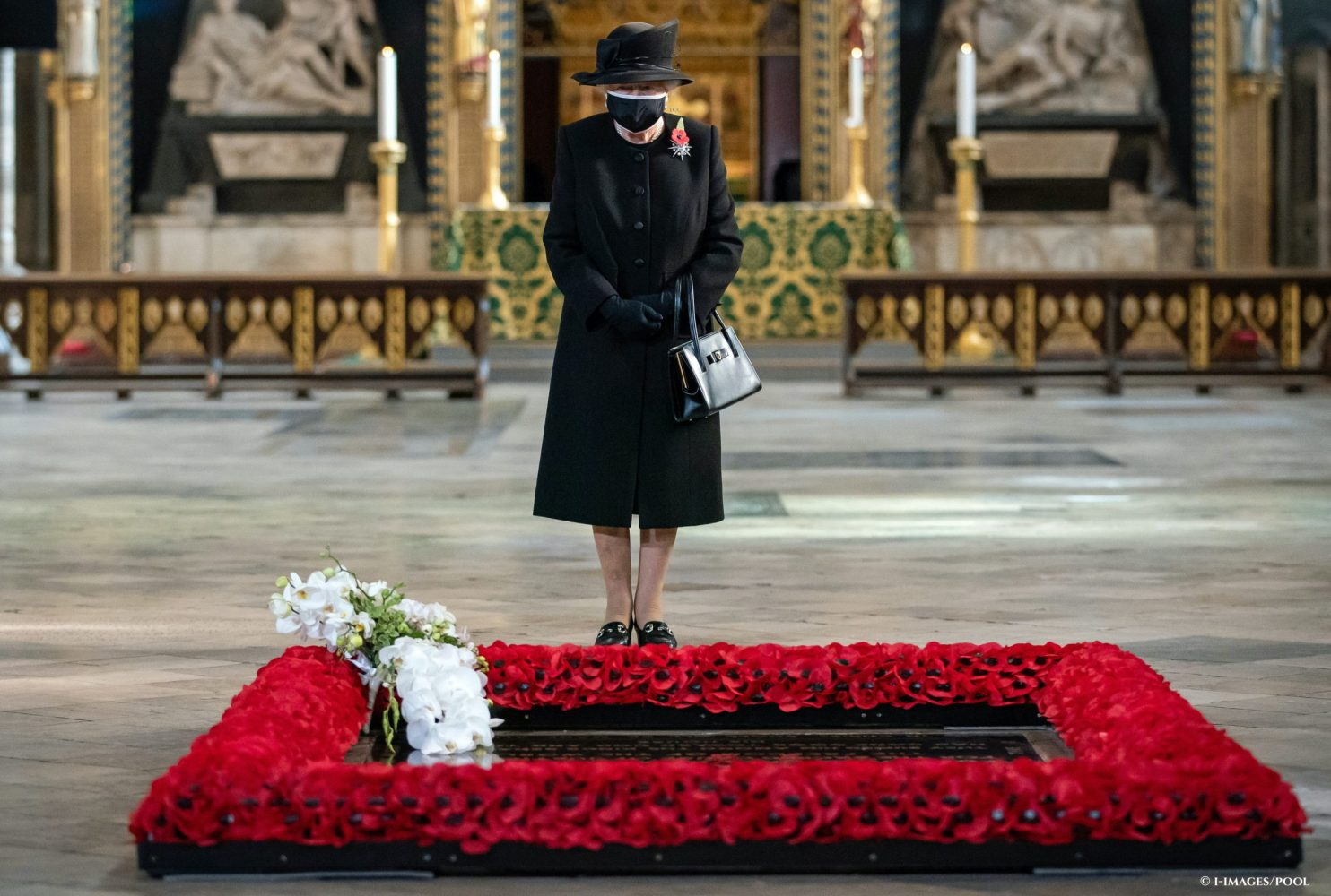 The Queen wears a face mask at a ceremony to mark the centenary of the burial of the Unknown Warrior at Westminster Abbey. Picture by  i-Images / Pool