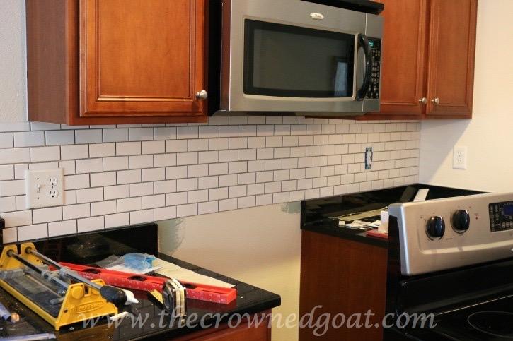kitchen diaries: subway tile backsplash grout day 2