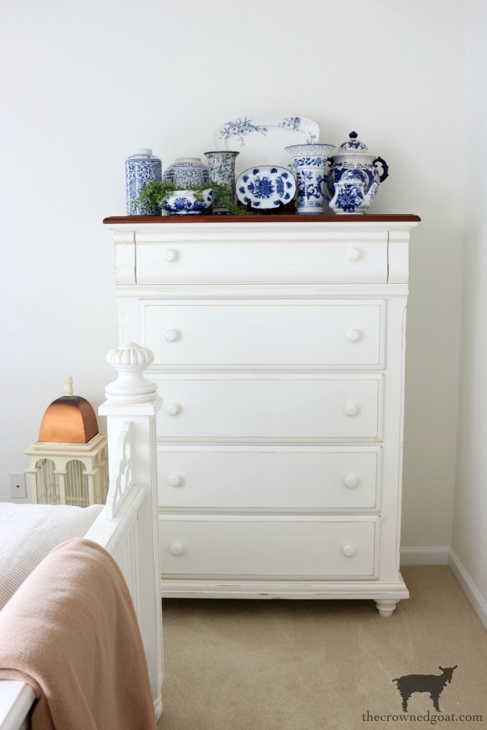 Blue-and-White-Collection-on-Dresser-Against-BM-White-Dove Blue and White Guest Bedroom Refresh Bliss Barracks Decorating DIY