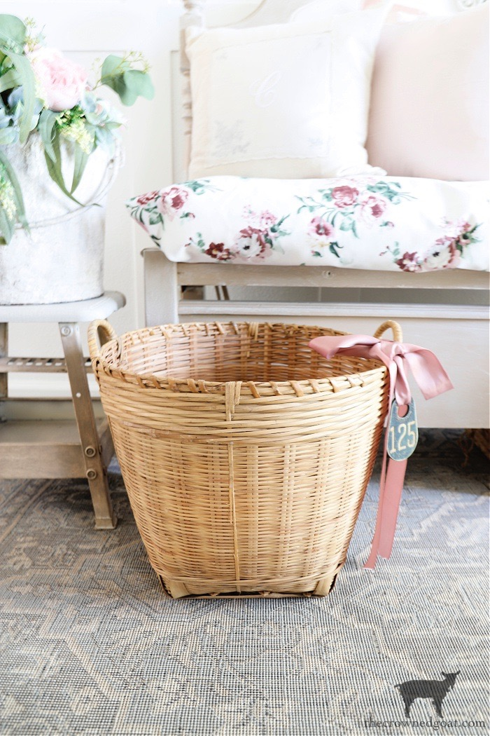 Dressing up a basket with a vintage cow tag and ribbon - The Crowned Goat