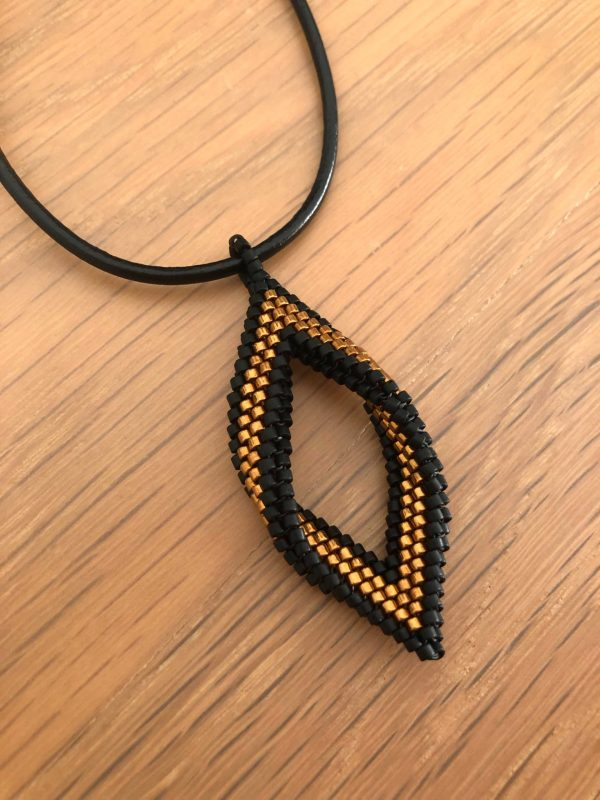 matt black and copper hand beaded open leaf pendant with leather cord