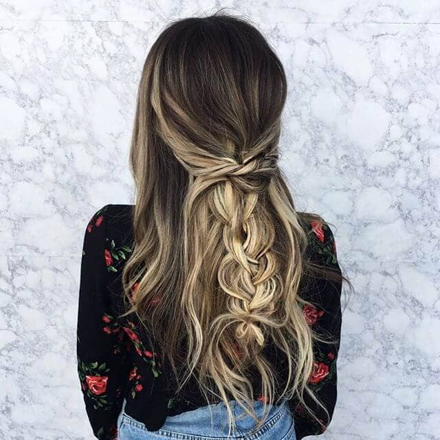 Dramatic Blonde Highlights Pulled Back in a Braid